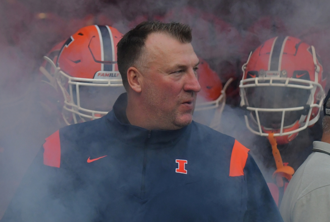 Sep 4, 2021; Champaign, Illinois, USA;  Illinois Fighting Illini head coach Bret Bielema enters the field with his team before the start of Saturday   s game with the UTSA Roadrunners at Memorial Stadium. Mandatory Credit: Ron Johnson-USA TODAY Sports