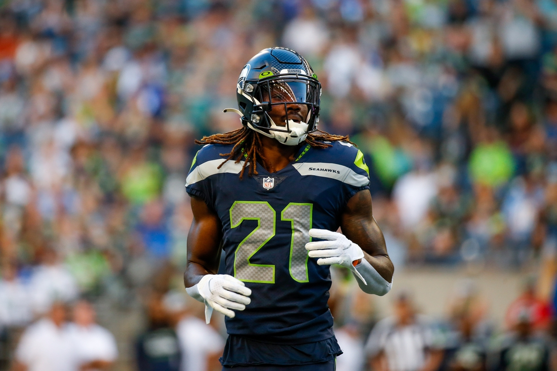 Aug 28, 2021; Seattle, Washington, USA; Seattle Seahawks cornerback Tre Flowers (21) waits for a snap against the Los Angeles Chargers during the first quarter at Lumen Field. Mandatory Credit: Joe Nicholson-USA TODAY Sports