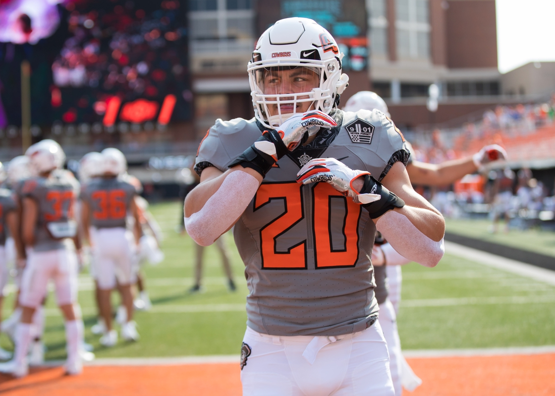 Sep 11, 2021; Stillwater, Oklahoma, USA; Oklahoma State Cowboys linebacker Malcolm Rodriguez (20) warms up before the game against the Tulsa Golden Hurricane at Boone Pickens Stadium. Mandatory Credit: Brett Rojo-USA TODAY Sports