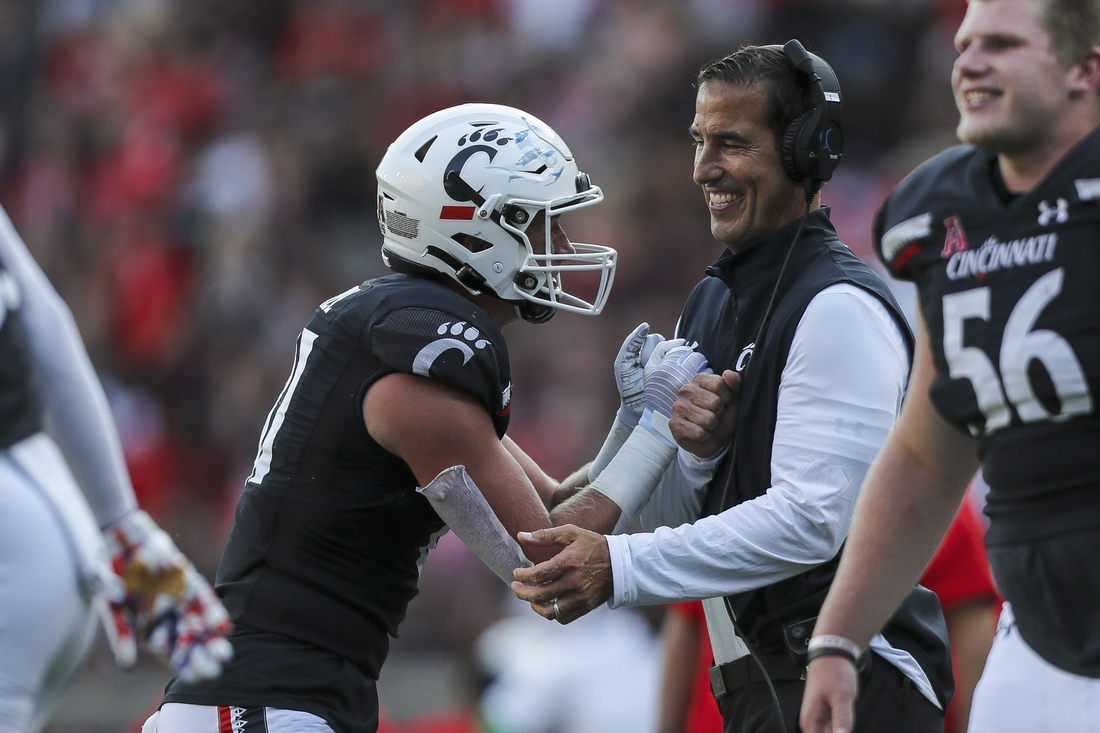 Sep 11, 2021; Cincinnati, Ohio, USA; Cincinnati Bearcats tight end Josh Whyle (81) celebrates after a touchdown with head coach Luke Fickell in the second half against the Murray State Racers at Nippert Stadium. Mandatory Credit: Katie Stratman-USA TODAY Sports