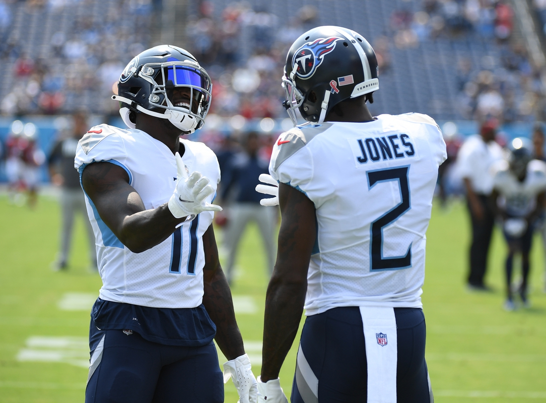Sep 12, 2021; Nashville, Tennessee, USA; Tennessee Titans wide receiver A.J. Brown (11) and Tennessee Titans wide receiver Julio Jones (2) before the game against the Arizona Cardinals at Nissan Stadium. Mandatory Credit: Christopher Hanewinckel-USA TODAY Sports