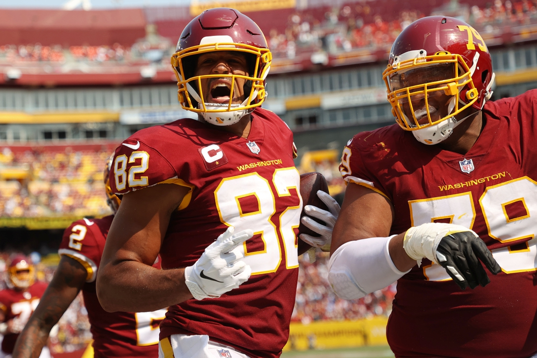 Sep 12, 2021; Landover, Maryland, USA; Washington Football Team tight end Logan Thomas (82) celebrates with Washington Football Team offensive tackle Ereck Flowers (79) after scoring a touchdown against the Los Angeles Chargers in the third quarter at FedExField. Mandatory Credit: Geoff Burke-USA TODAY Sports