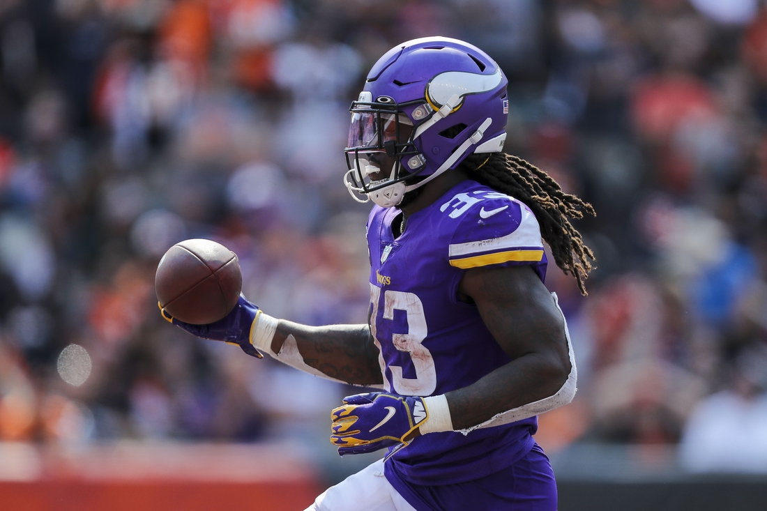 Sep 12, 2021; Cincinnati, Ohio, USA; Minnesota Vikings running back Dalvin Cook (33) runs with the ball for a touchdown in the second half against the Cincinnati Bengals at Paul Brown Stadium. Mandatory Credit: Katie Stratman-USA TODAY Sports