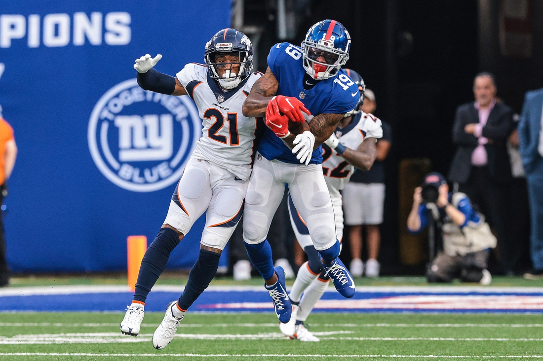 Sep 12, 2021; East Rutherford, New Jersey, USA; New York Giants wide receiver Kenny Golladay (19) catches the ball over Denver Broncos cornerback Ronald Darby (21) during the second half at MetLife Stadium. Mandatory Credit: Vincent Carchietta-USA TODAY Sports