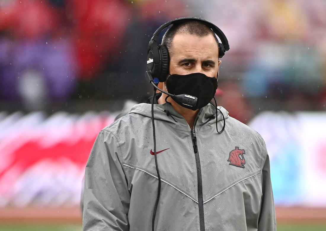 Sep 18, 2021; Pullman, Washington, USA; Washington State Cougars head coach Nick Rolovich looks on during a game against the USC Trojans in the first half at Gesa Field at Martin Stadium. Mandatory Credit: James Snook-USA TODAY Sports
