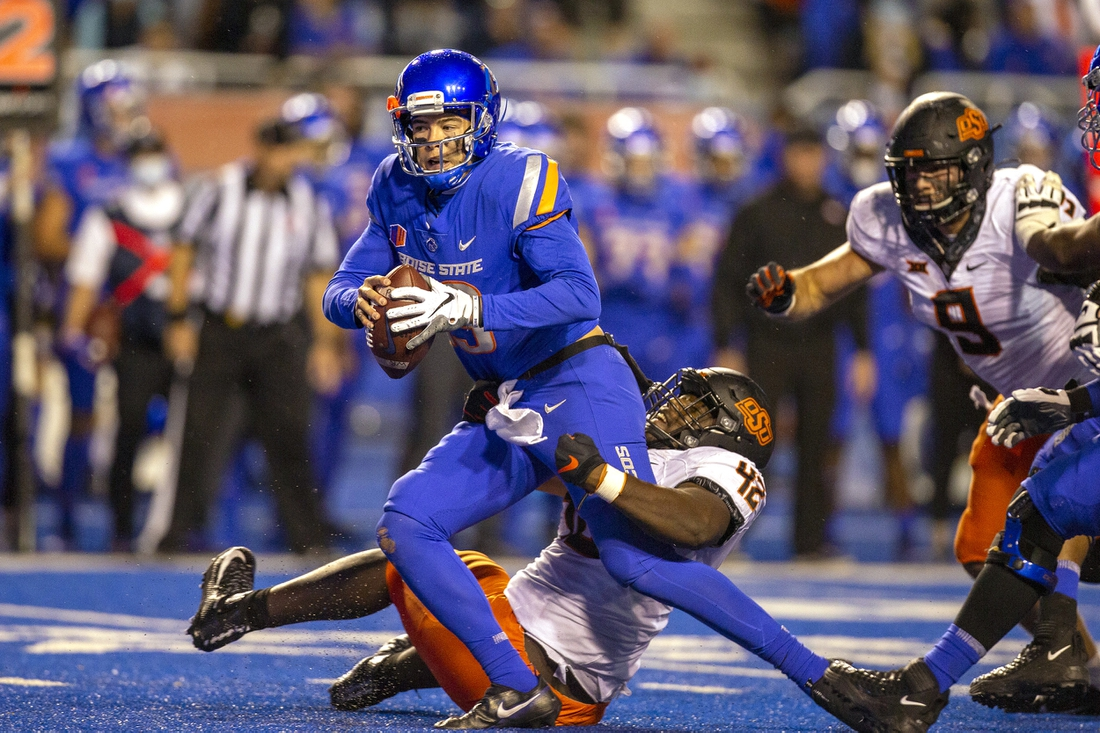 Sep 18, 2021; Boise, Idaho, USA; Boise State Broncos quarterback Hank Bachmeier (19) is sacked by Oklahoma State Cowboys defensive tackle Jayden Jernigan (42) during the second half at Albertsons Stadium. Oklahoma State won 21-20. Mandatory Credit: Brian Losness-USA TODAY Sports