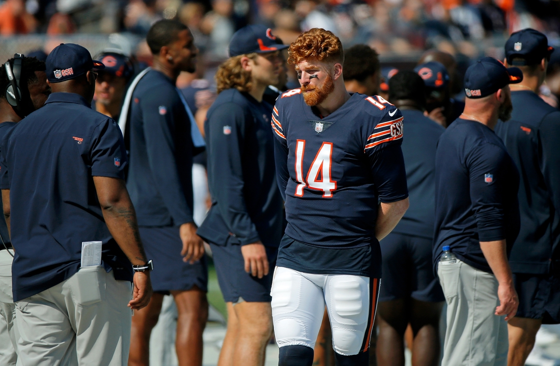 Sep 19, 2021; Chicago, Illinois, USA; Chicago Bears quarterback Andy Dalton (14) stands on the sideline during the fourth quarter of their game against the Cincinnati Bengals at Soldier Field. Mandatory Credit: Jon Durr-USA TODAY Sports