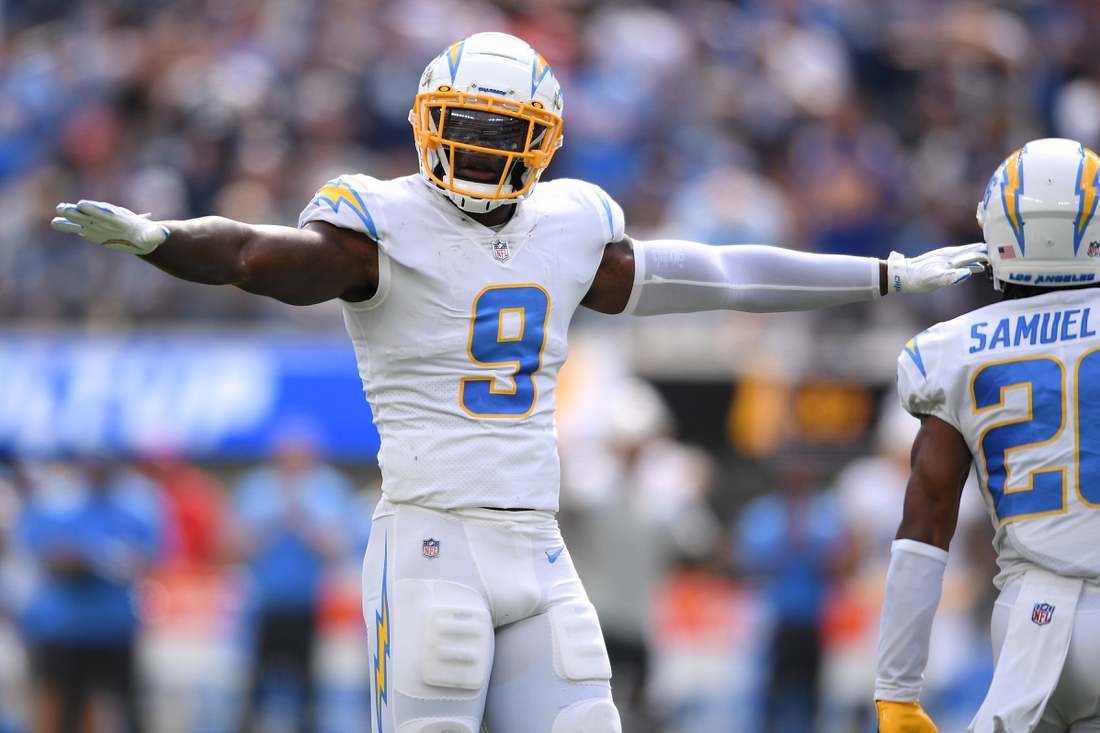 Sep 19, 2021; Inglewood, California, USA; Los Angeles Chargers linebacker Kenneth Murray (9) gestures after a play against the Dallas Cowboys during the first half at SoFi Stadium. Mandatory Credit: Orlando Ramirez-USA TODAY Sports