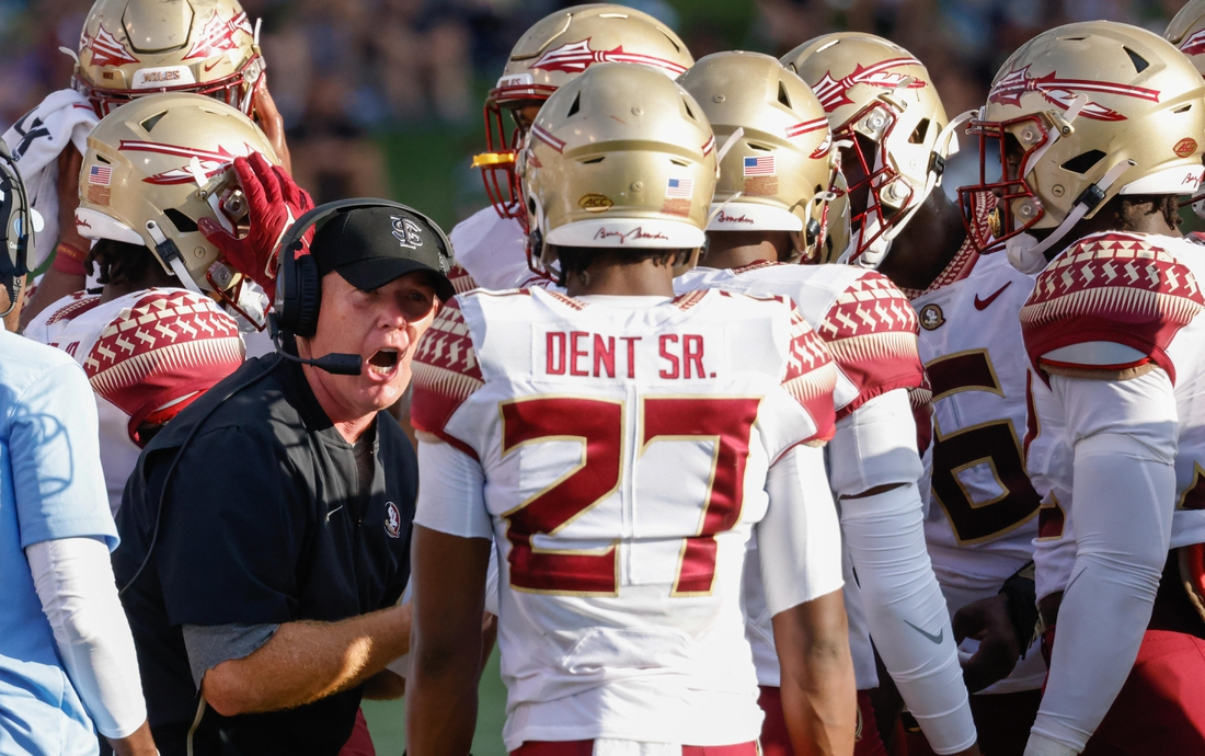 Sep 18, 2021; Winston-Salem, North Carolina, USA; Florida State Seminoles defensive back Akeem Dent Sr. (27) listens to defensive coordinator Adam Fuller (left) as he talks with the defensive unit during the second half against the Wake Forest Demon Deacons at Truist Field. Mandatory Credit: Reinhold Matay-USA TODAY Sports