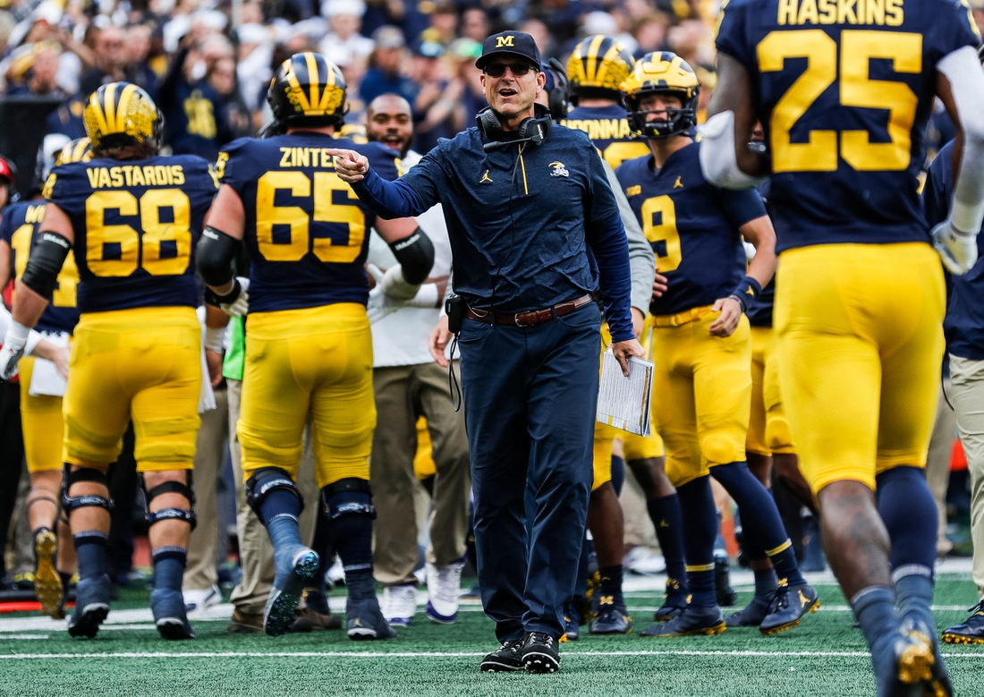 Michigan head coach Jim Harbaugh celebrates a touchdown against Rutgers during the first half at Michigan Stadium in Ann Arbor on Saturday, Sept. 25, 2021.