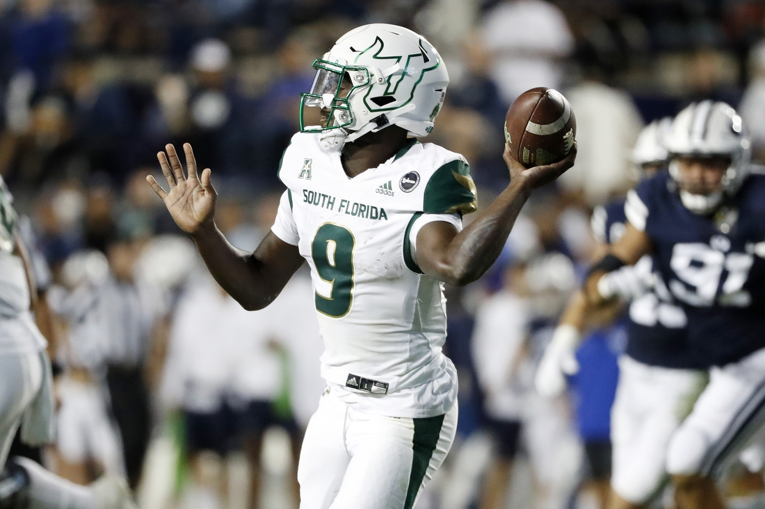 Sep 25, 2021; Provo, Utah, USA; South Florida Bulls quarterback Timmy McClain (9) looks to pass in the second quarter against the Brigham Young Cougars at LaVell Edwards Stadium. Mandatory Credit: Jeffrey Swinger-USA TODAY Sports