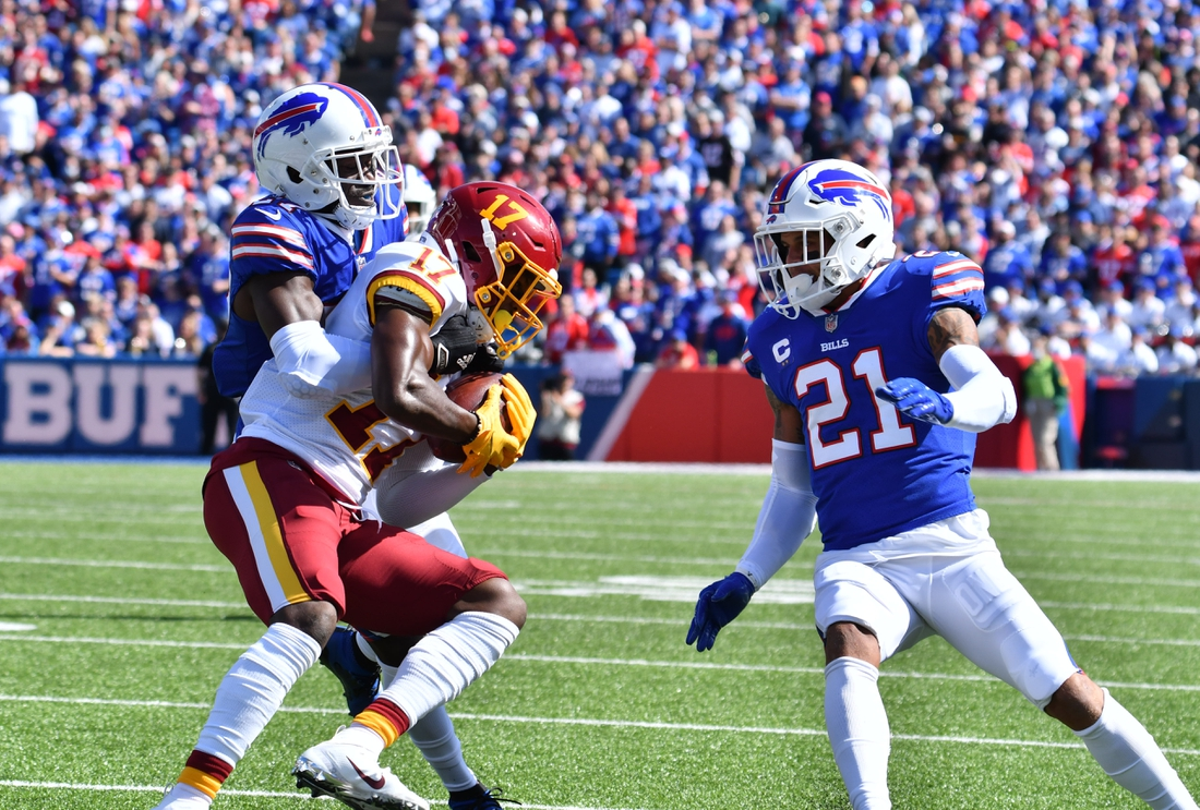 Sep 26, 2021; Orchard Park, New York, USA; Washington Football Team wide receiver Terry McLaurin (17) is tackled by Buffalo Bills cornerback Tre'Davious White (27) and free safety Jordan Poyer (21) after a catch in the first quarter at Highmark Stadium. Mandatory Credit: Mark Konezny-USA TODAY Sports