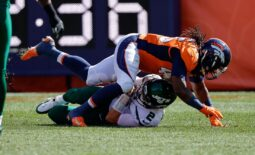 Sep 26, 2021; Denver, Colorado, USA; New York Jets quarterback Zach Wilson (2) is sacked by Denver Broncos linebacker Alexander Johnson (45) in the first quarter at Empower Field at Mile High. Mandatory Credit: Isaiah J. Downing-USA TODAY Sports