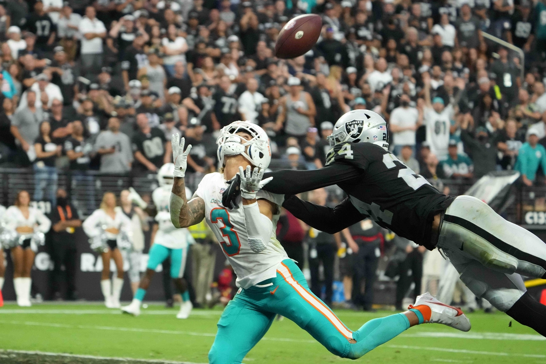 Sep 26, 2021; Paradise, Nevada, USA; Miami Dolphins wide receiver Will Fuller (3) is defended by Las Vegas Raiders defensive back Johnathan Abram (24) in overtime at Allegiant Stadium.The Raiders defeated the Dolphins 31-28 in overtime. Mandatory Credit: Kirby Lee-USA TODAY Sports