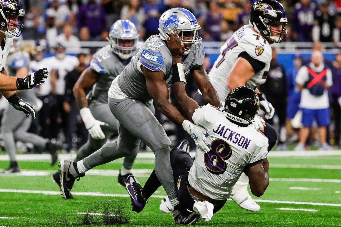 Sep 26, 2021; Detroit, MI, USA;  Detroit Lions linebacker Charles Harris sacks Baltimore Ravens quarterback Lamar Jackson during the second half of the Lions' 19-17 loss at Ford Field on Sunday, Sept. 26, 2021. Mandatory Credit: Junfu Han-USA TODAY Sports