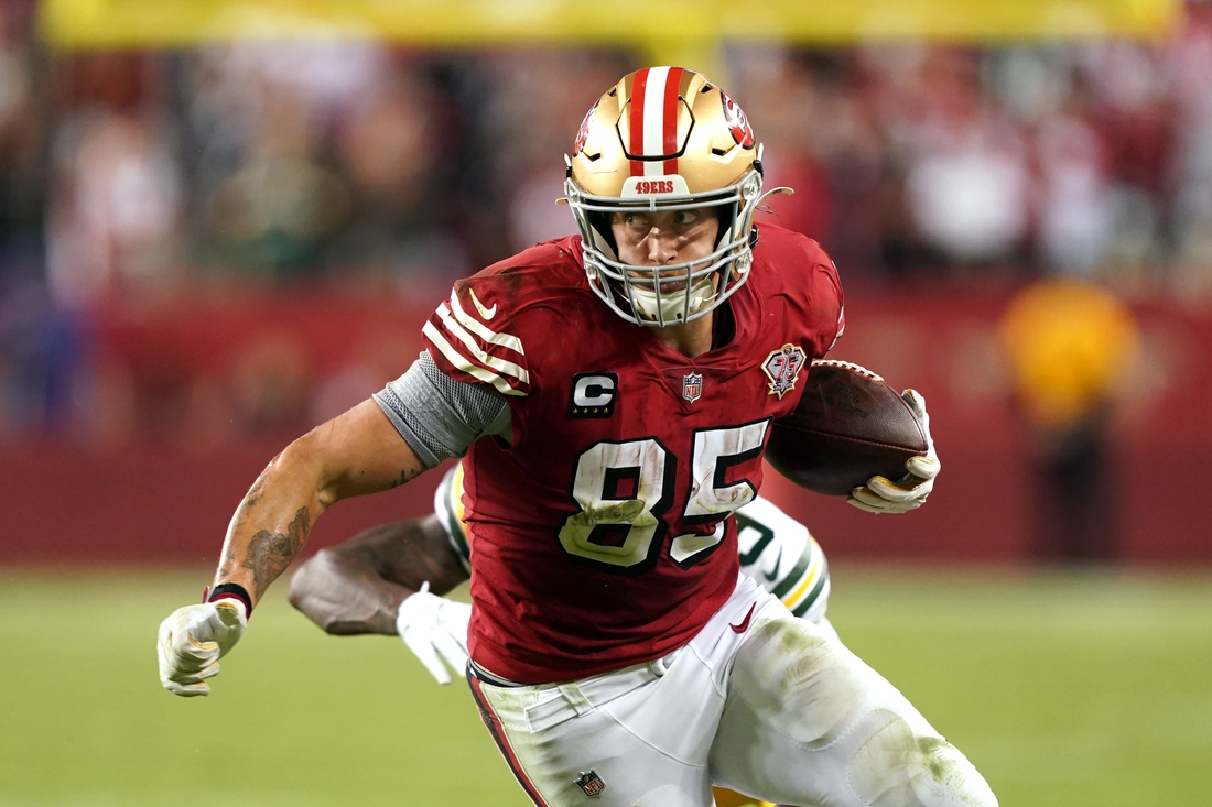 Sep 26, 2021; Santa Clara, California, USA; San Francisco 49ers tight end George Kittle (85) runs after a catch during the fourth quarter against the Green Bay Packers at Levi's Stadium. Mandatory Credit: Darren Yamashita-USA TODAY Sports