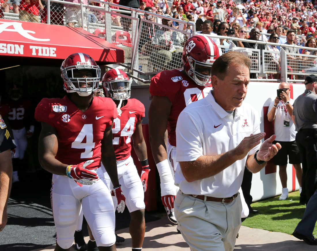 Coach Nick Saban leads the Crimson Tide players onto the field before Alabama's 49-7 victory over Southern Miss Saturday, Sept. 21, 2019 in Bryant-Denny Stadium. [Staff Photo/Gary Cosby Jr.]  Alabama Defeats Southern Miss