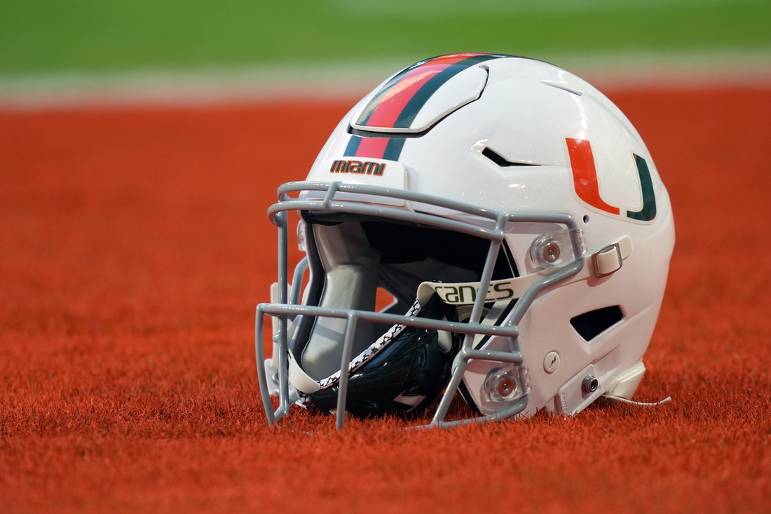 Sep 30, 2021; Miami Gardens, Florida, USA; A general view of a Miami Hurricanes helmet in the end zone prior to the game between the Miami Hurricanes and the Virginia Cavaliers at Hard Rock Stadium. Mandatory Credit: Jasen Vinlove-USA TODAY Sports