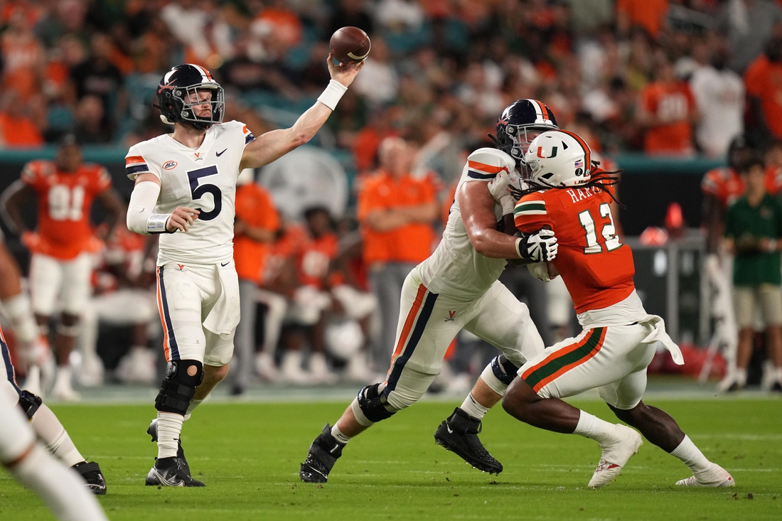 Sep 30, 2021; Miami Gardens, Florida, USA; Virginia Cavaliers quarterback Brennan Armstrong (5) attempts a pass against the Miami Hurricanes during the first half at Hard Rock Stadium. Mandatory Credit: Jasen Vinlove-USA TODAY Sports