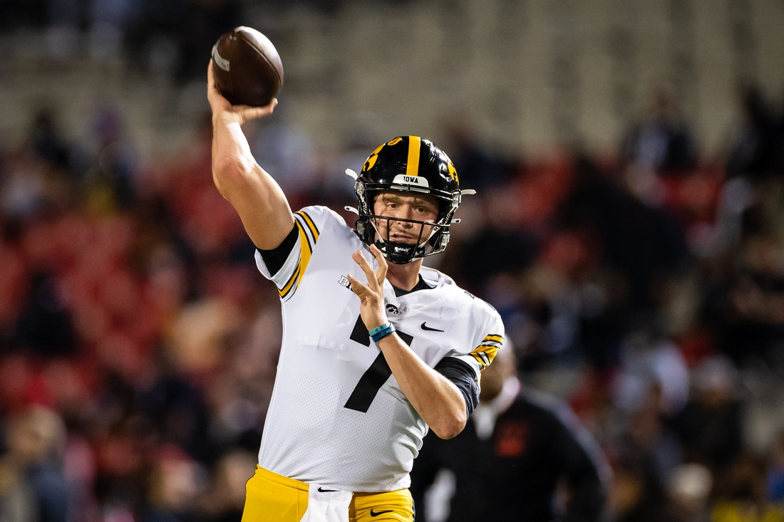 Oct 1, 2021; College Park, Maryland, USA; Iowa Hawkeyes quarterback Spencer Petras (7) warms up before the game against the Maryland Terrapins at Capital One Field at Maryland Stadium. Mandatory Credit: Scott Taetsch-USA TODAY Sports