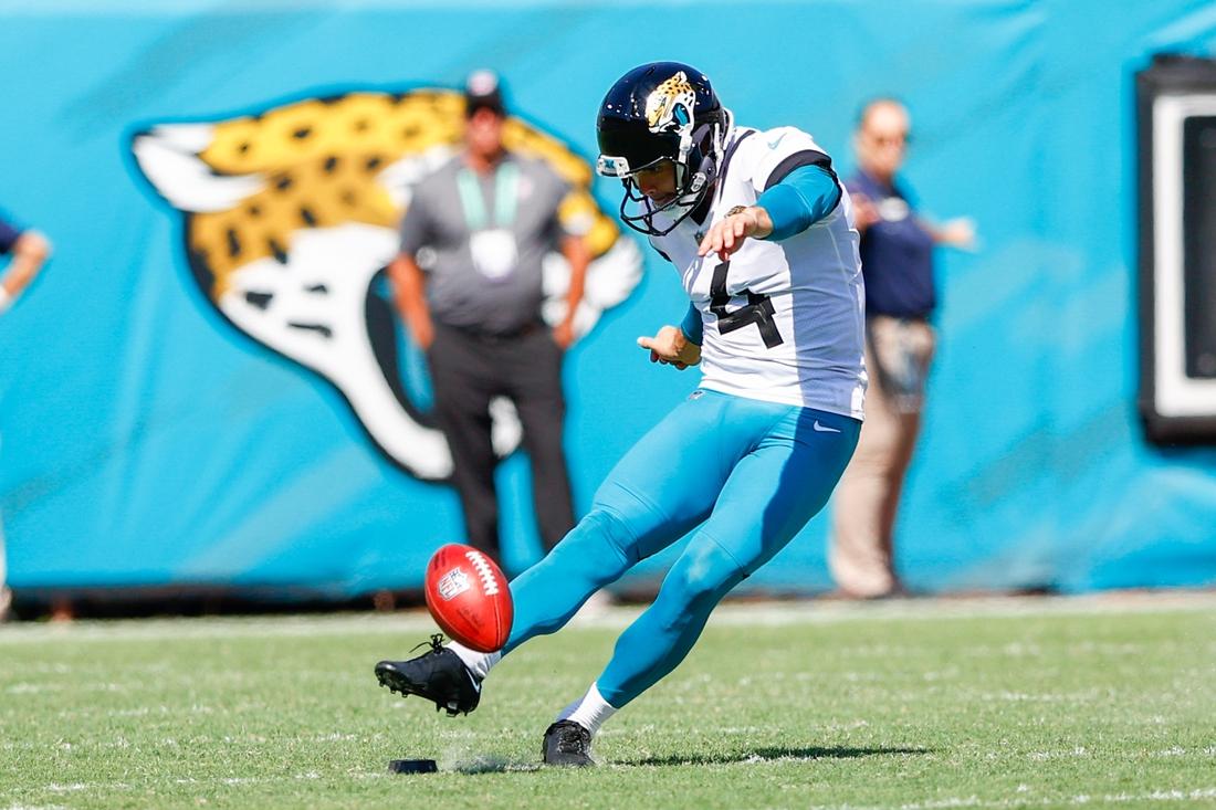 Sep 26, 2021; Jacksonville, Florida, USA;  Jacksonville Jaguars kicker Josh Lambo (4) kicks the ball in the third quarter against the Arizona Cardinals at TIAA Bank Field. Mandatory Credit: Nathan Ray Seebeck-USA TODAY Sports