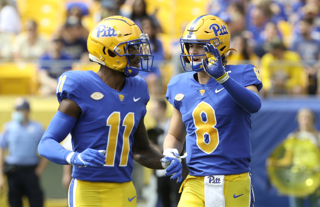 Sep 25, 2021; Pittsburgh, Pennsylvania, USA;  Pittsburgh Panthers wide receiver Taysir Mack (11) and quarterback Kenny Pickett (8) talk before a play against the New Hampshire Wildcats during the second quarter at Heinz Field. Mandatory Credit: Charles LeClaire-USA TODAY Sports