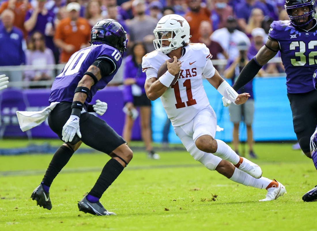 Oct 2, 2021; Fort Worth, Texas, USA; Texas Longhorns quarterback Casey Thompson (11) runs with the ball as TCU Horned Frogs safety Da'Veawn Armstead (10) defends during the first quarter at Amon G. Carter Stadium. Mandatory Credit: Kevin Jairaj-USA TODAY Sports