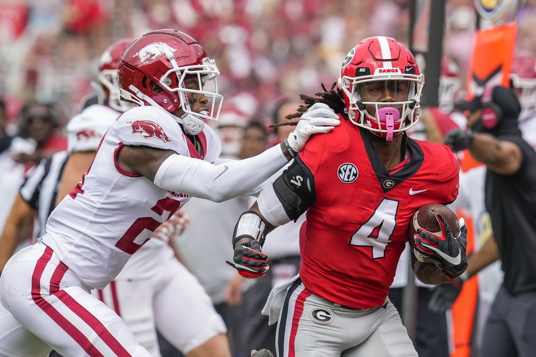 Oct 2, 2021; Athens, Georgia, USA; Georgia Bulldogs running back James Cook (4) gets knocked out of bounds by Arkansas Razorbacks defensive back Montaric Brown (21) during the first quarter at Sanford Stadium. Mandatory Credit: Dale Zanine-USA TODAY Sports