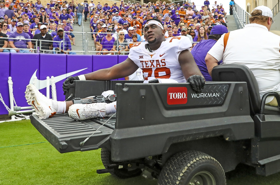 Oct 2, 2021; Fort Worth, Texas, USA; Texas Longhorns offensive lineman Denzel Okafor (78) leaves the game on a cart during the first half against the TCU Horned Frogs at Amon G. Carter Stadium. Mandatory Credit: Kevin Jairaj-USA TODAY Sports