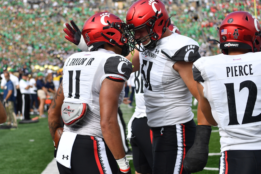 Oct 2, 2021; South Bend, Indiana, USA; Cincinnati Bearcats tight end Leonard Taylor (11) celebrates after a touchdown in the second quarter against the Notre Dame Fighting Irish at Notre Dame Stadium. Mandatory Credit: Matt Cashore-USA TODAY Sports
