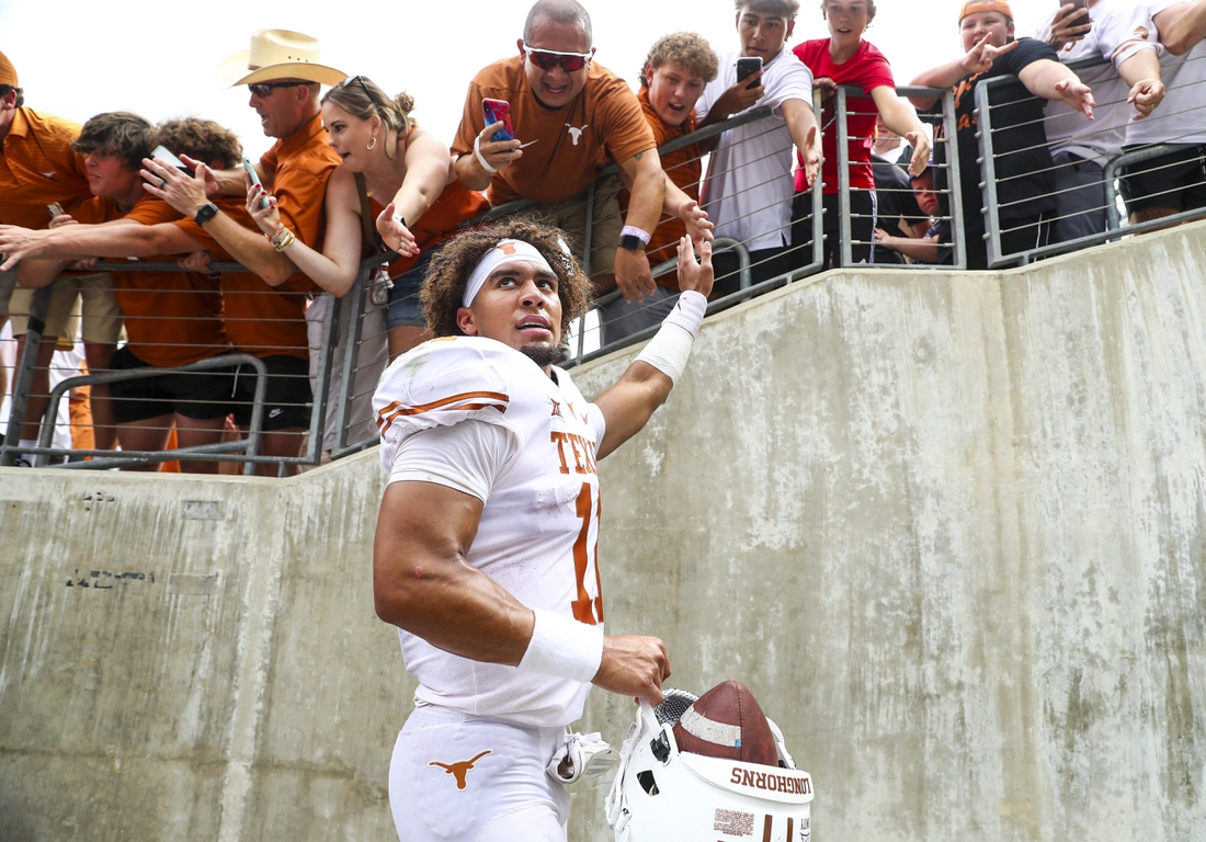 Oct 2, 2021; Fort Worth, Texas, USA; Texas Longhorns quarterback Casey Thompson (11) shakes hands with fans after the game against the TCU Horned Frogs at Amon G. Carter Stadium. Mandatory Credit: Kevin Jairaj-USA TODAY Sports