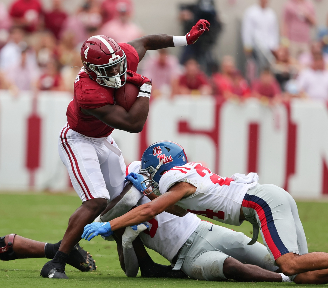Oct 2, 2021; Tuscaloosa, Alabama, USA; Alabama Crimson Tide running back Brian Robinson Jr. (4) carries the ball against the Mississippi Rebels during the first half of an NCAA college football game at Bryant-Denny Stadium. Mandatory Credit: Butch Dill-USA TODAY Sports