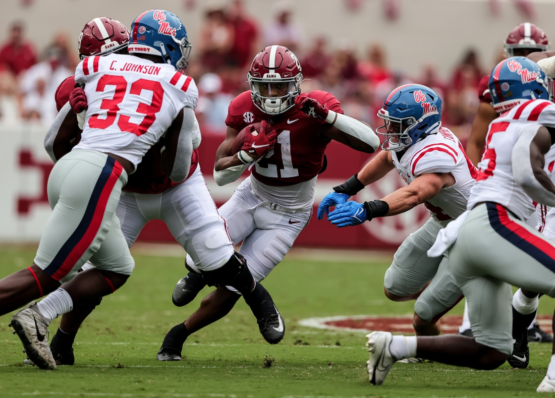 Oct 2, 2021; Tuscaloosa, Alabama, USA;  Alabama Crimson Tide running back Jase McClellan (21) carries the ball against the Mississippi Rebels during the first half of an NCAA college football game at Bryant-Denny Stadium. Mandatory Credit: Butch Dill-USA TODAY Sports