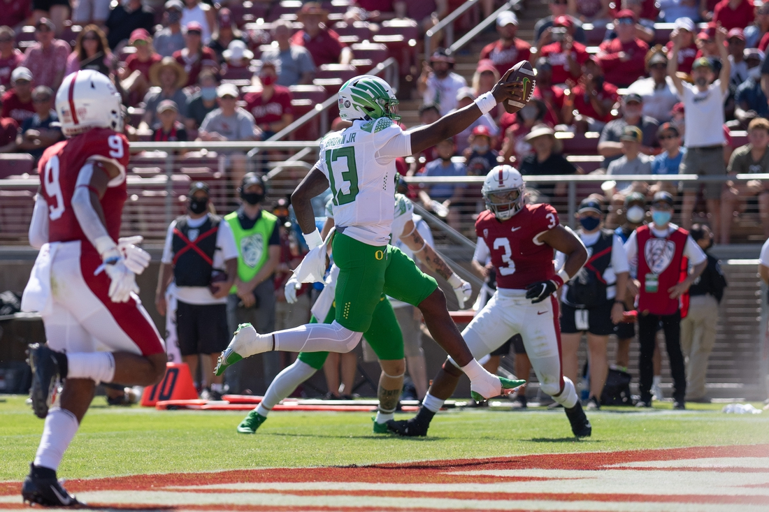 Oct 2, 2021; Stanford, California, USA;  Oregon Ducks quarterback Anthony Brown (13) scores during the second quarter against the Stanford Cardinal at Stanford Stadium. Mandatory Credit: Stan Szeto-USA TODAY Sports