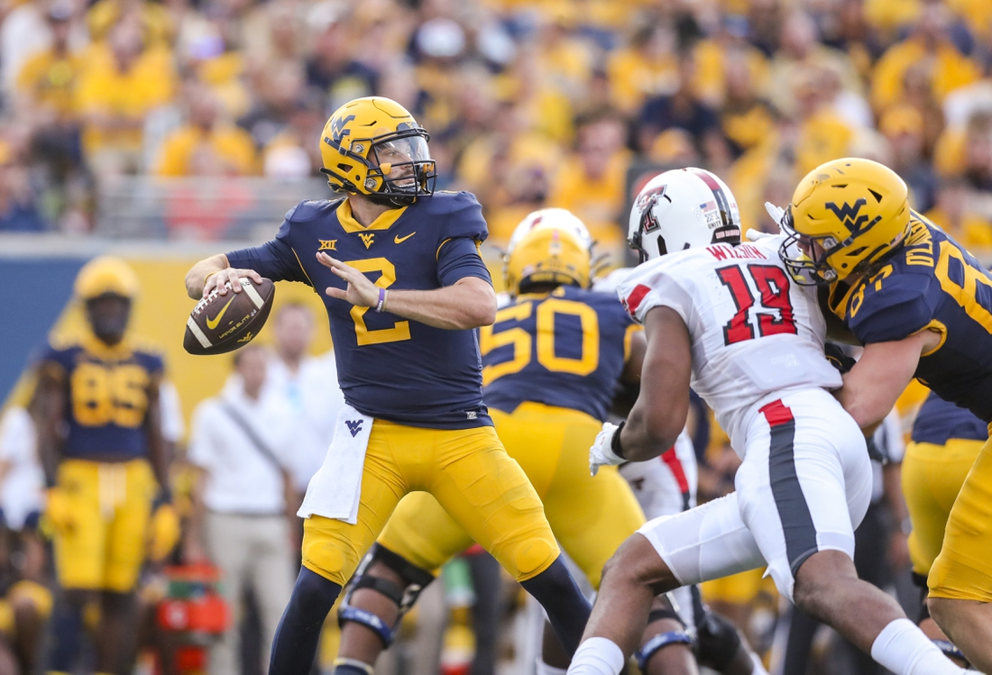 Oct 2, 2021; Morgantown, West Virginia, USA; West Virginia Mountaineers quarterback Jarret Doege (2) passes the ball during the fourth quarter against the Texas Tech Red Raiders at Mountaineer Field at Milan Puskar Stadium. Mandatory Credit: Ben Queen-USA TODAY Sports