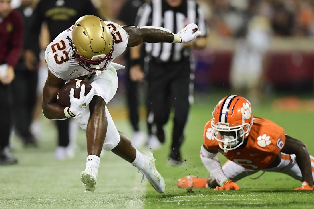 Oct 2, 2021; Clemson, South Carolina, USA; Boston College Eagles running back Travis Levy (23) is pushed out of bounds by Clemson Tigers cornerback Sheridan Jones (6) during the second quarter at Memorial Stadium. Mandatory Credit: Adam Hagy-USA TODAY Sports