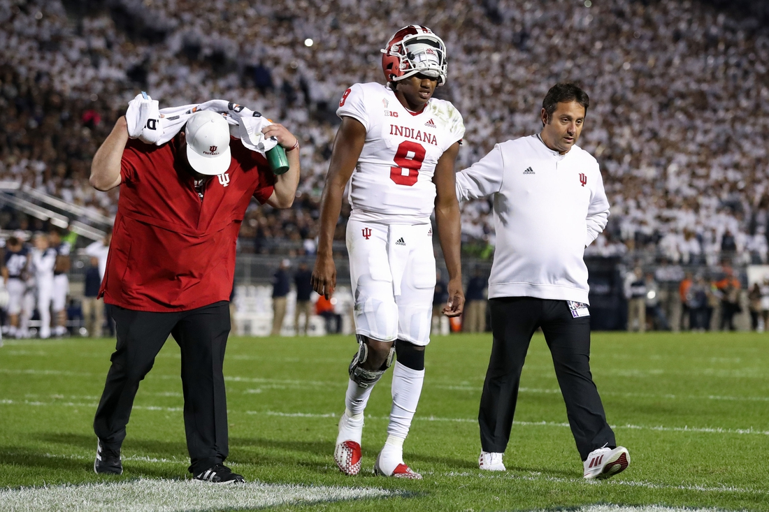 Oct 2, 2021; University Park, Pennsylvania, USA; Indiana Hoosiers quarterback Michael Penix Jr. (9) walks off the field after suffering an injury during the third quarter against the Penn State Nittany Lions at Beaver Stadium. Mandatory Credit: Matthew OHaren-USA TODAY Sports