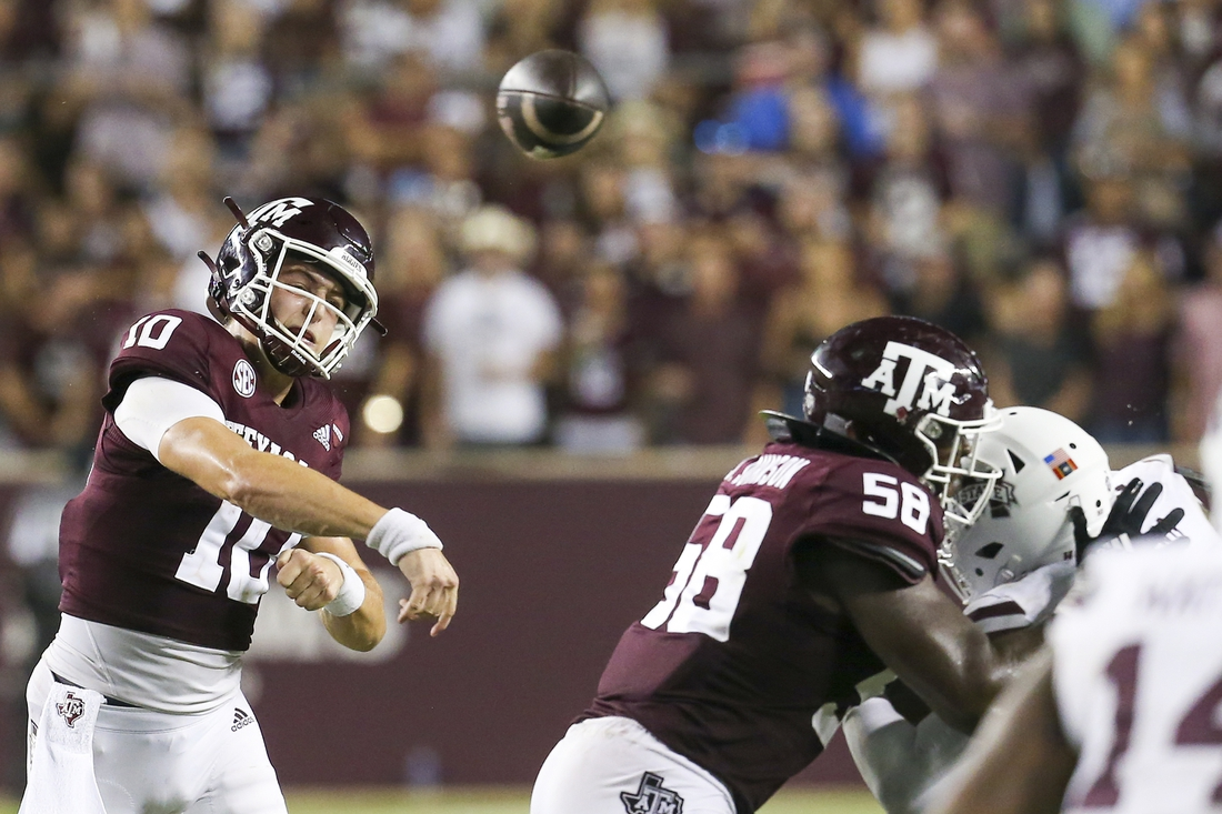 Oct 2, 2021; College Station, Texas, USA;  Texas A&M Aggies quarterback Zach Calzada (10) passes against the Mississippi State Bulldogs in the fourth quarter at Kyle Field. Mandatory Credit: Thomas Shea-USA TODAY Sports