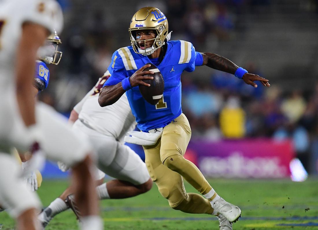 Oct 2, 2021; Pasadena, California, USA; UCLA Bruins quarterback Dorian Thompson-Robinson (1) runs the ball against the Arizona State Sun Devils during the first half at Rose Bowl. Mandatory Credit: Gary A. Vasquez-USA TODAY Sports