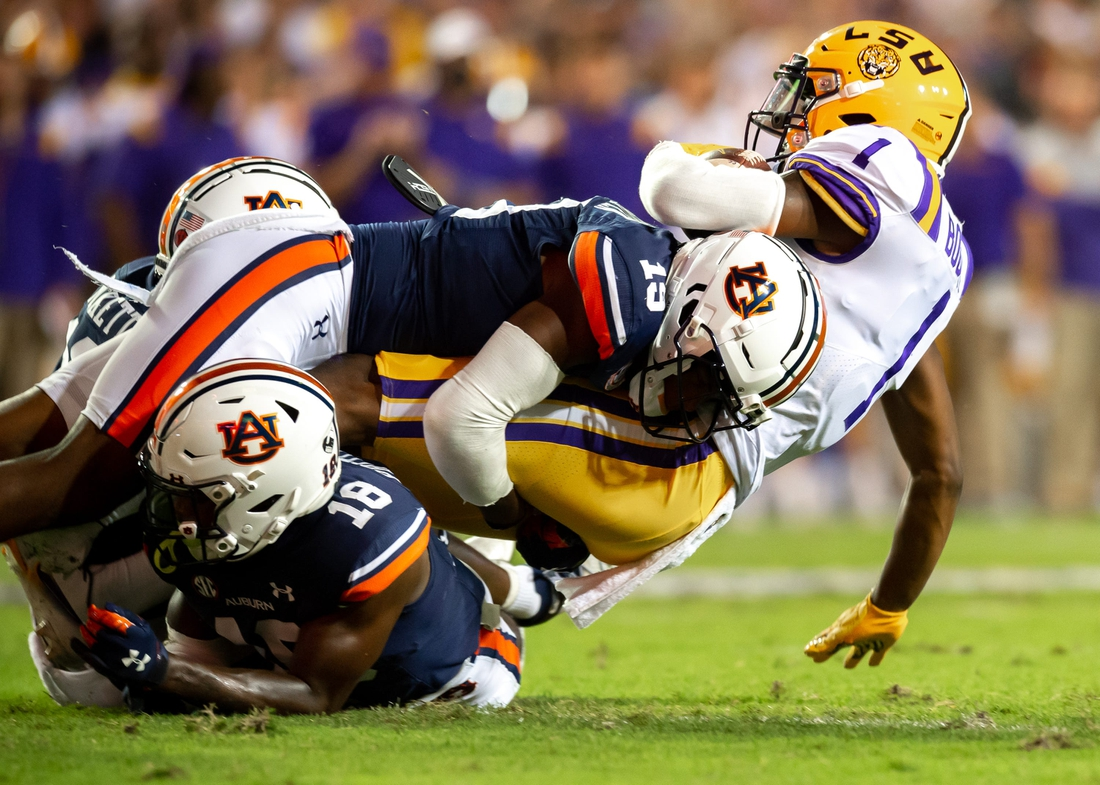 Kayshon Boutte 1 is tackled as The LSU Tigers take on the Auburn Tigers in Tiger Stadium. Saturday, Oct. 2, 2021.  Half 1 Lsu Vs Auburn Football 0805