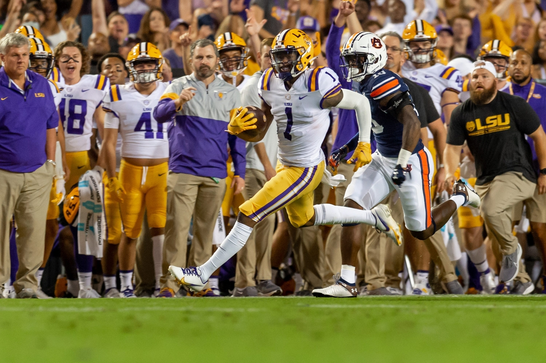 Kayshon Boutte (5) gained 55 yards on LSU's first play and capped the drive with a 31-yard touchdown reception.  Syndication The Daily Advertiser