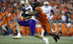 Oct 2, 2021; Corvallis, Oregon, USA; Washington Huskies wide receiver Jalen McMillan (left) is tackled by Oregon State Beavers inside linebacker Avery Roberts (34) during the second half at Reser Stadium. Mandatory Credit: Soobum Im-USA TODAY Sports