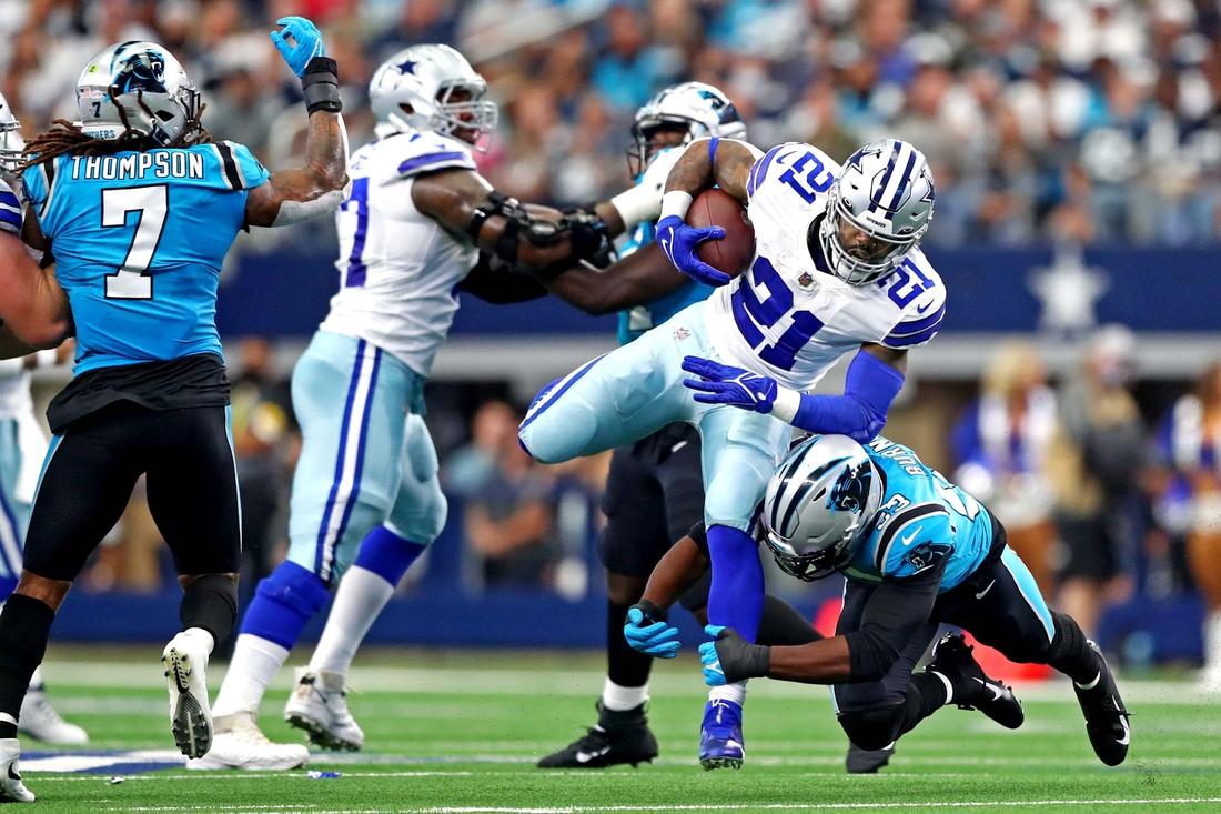 Oct 3, 2021; Arlington, Texas, USA; Dallas Cowboys running back Ezekiel Elliott (21) runs the ball against Carolina Panthers defensive end Brian Burns (53) during the first quarter at AT&T Stadium. Mandatory Credit: Mark J. Rebilas-USA TODAY Sports