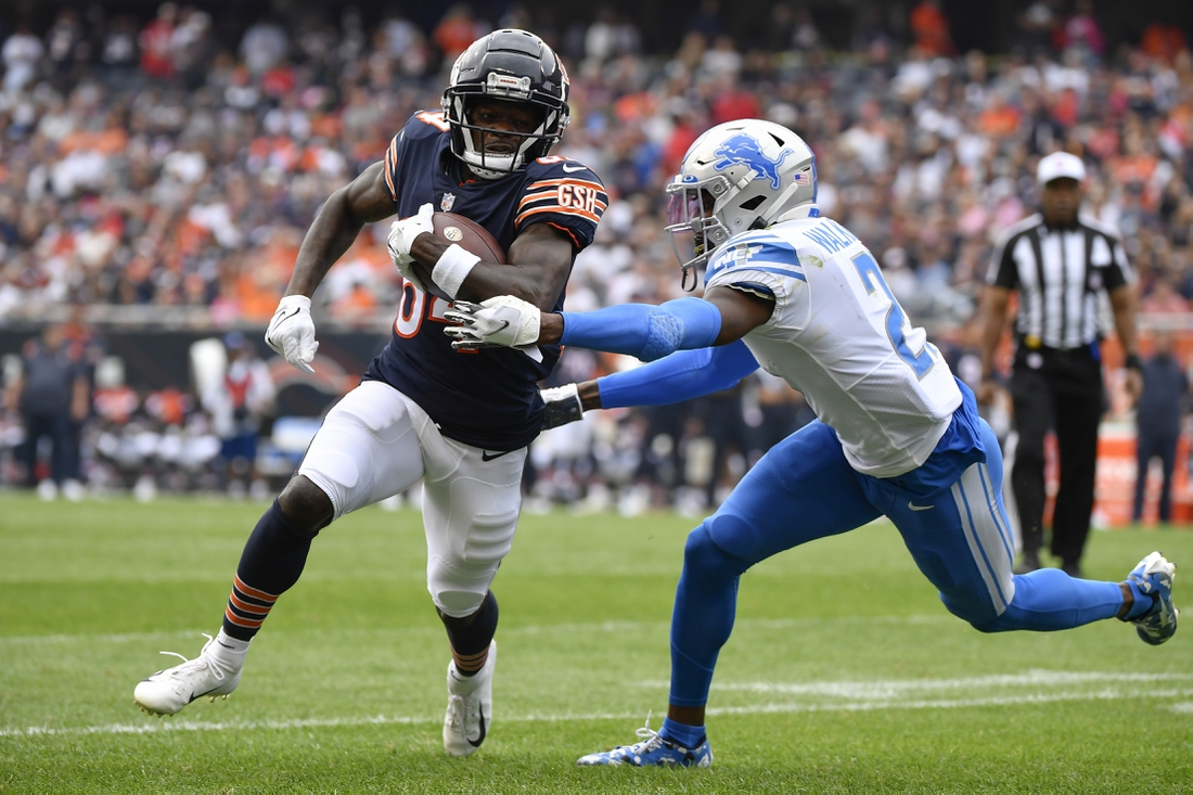 Oct 3, 2021; Chicago, Illinois, USA; Chicago Bears wide receiver Marquise Goodwin (84) runs with the football in the first half against Detroit Lions free safety Tracy Walker III (21) at Soldier Field. Mandatory Credit: Quinn Harris-USA TODAY Sports