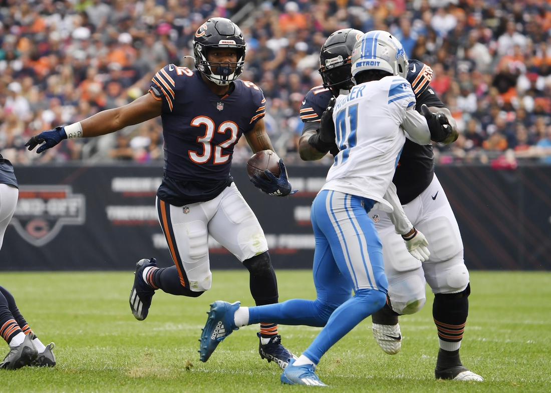Oct 3, 2021; Chicago, Illinois, USA; Chicago Bears running back David Montgomery (32) runs with the football in the first half against the Detroit Lions at Soldier Field. Mandatory Credit: Quinn Harris-USA TODAY Sports