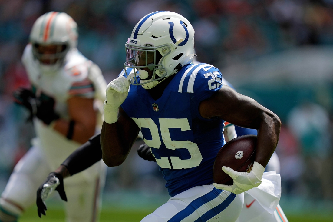 Oct 3, 2021; Miami Gardens, Florida, USA; Indianapolis Colts running back Marlon Mack (25) runs the ball against the Miami Dolphins during the first half at Hard Rock Stadium. Mandatory Credit: Jasen Vinlove-USA TODAY Sports