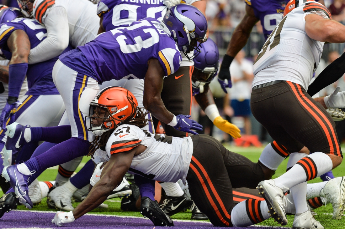 Oct 3, 2021; Minneapolis, Minnesota, USA; Cleveland Browns running back Kareem Hunt (27) reaches for the endzone to score a touchdown as Minnesota Vikings free safety Xavier Woods (23) defends during the second quarter at U.S. Bank Stadium. Mandatory Credit: Jeffrey Becker-USA TODAY Sports