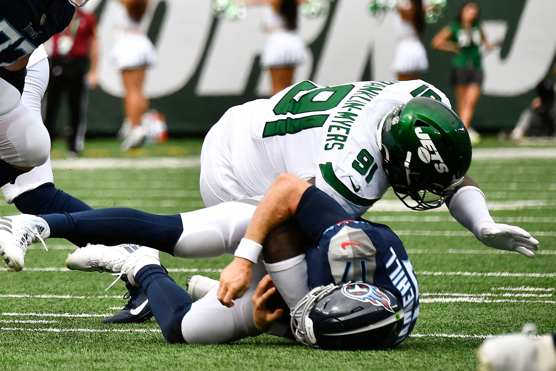 Tennessee Titans quarterback Ryan Tannehill (17) is sacked by New York Jets defensive end John Franklin-Myers (91) during the second quarter at MetLife Stadium Sunday, Oct. 3, 2021 in East Rutherford, N.J.  Titans Jets 60