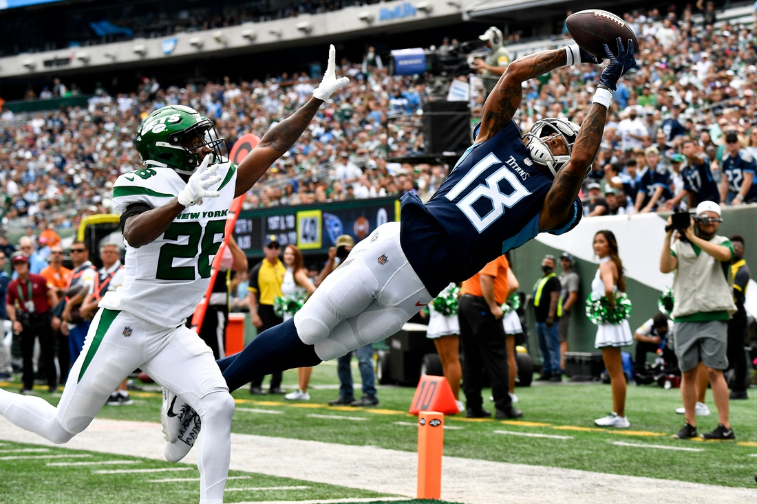 Oct 3, 2021; East Rutherford, NJ, USA;   Tennessee Titans wide receiver Josh Reynolds (18) pulls in a catch against New York Jets cornerback Brandin Echols (26) that was ruled out of bounds during the first quarter at MetLife Stadium Sunday, Oct. 3, 2021 in East Rutherford, N.J. Mandatory Credit: George Walker IV-USA TODAY Sports