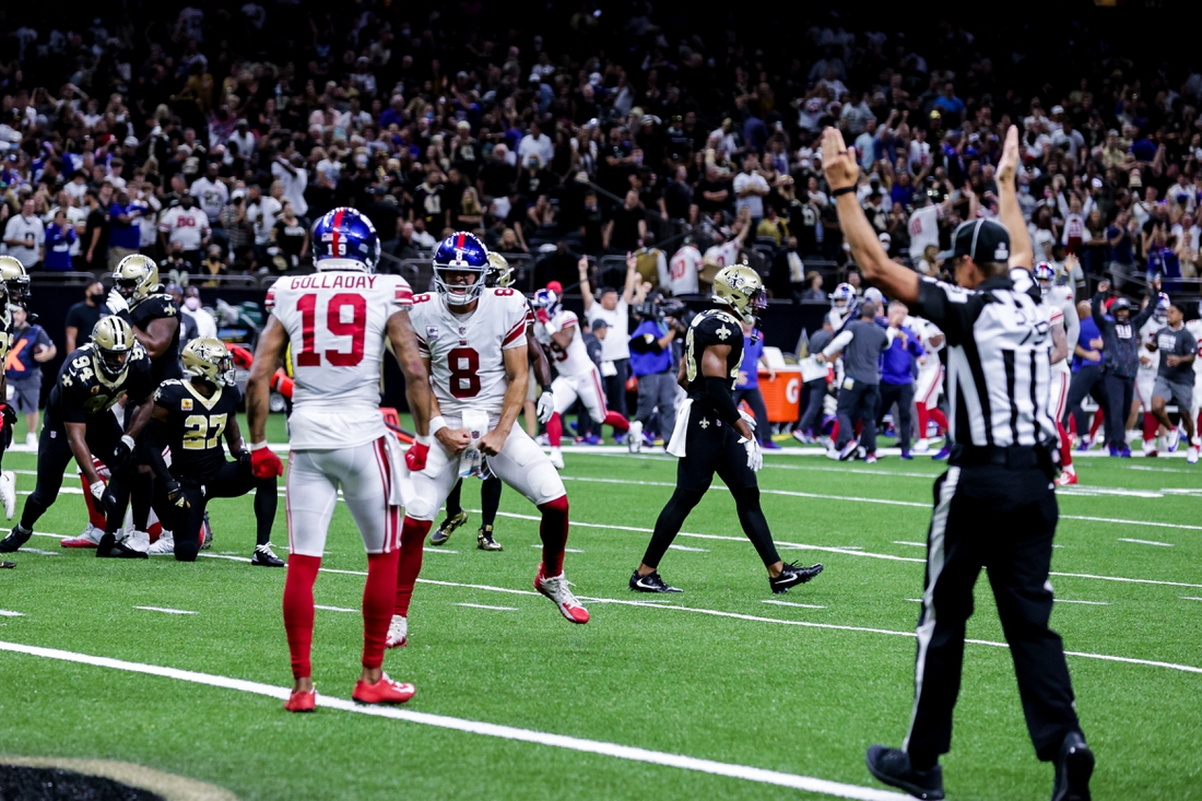 Oct 3, 2021; New Orleans, Louisiana, USA;  New York Giants quarterback Daniel Jones (8) reacts to a winning touchdown against the New Orleans Saints  in overtime  at Caesars Superdome. Mandatory Credit: Stephen Lew-USA TODAY Sports